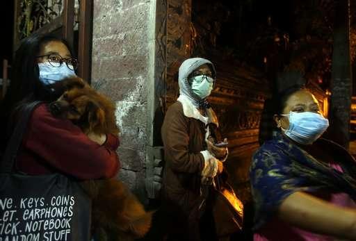 Bali volcano dusts resorts in ash; Lombok airport closes