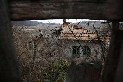 Lake created by coal waste landslide floods Bosnian highway
