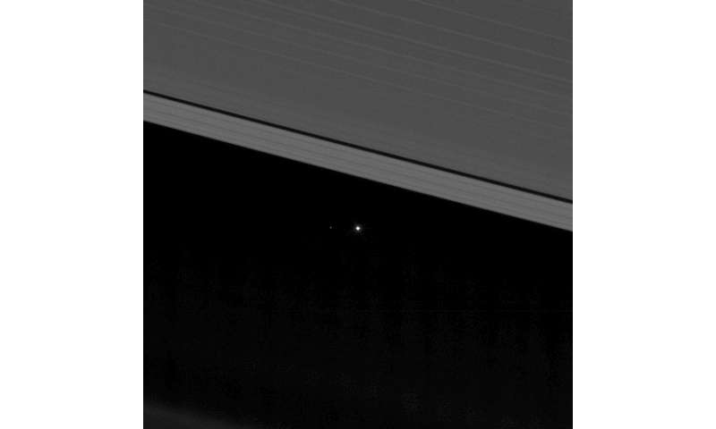 NASA image captures Earth between the rings of Saturn