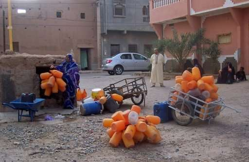 Residents of the southern Moroccan town of Zagora wait to fill containers with water from a public well as they face water short
