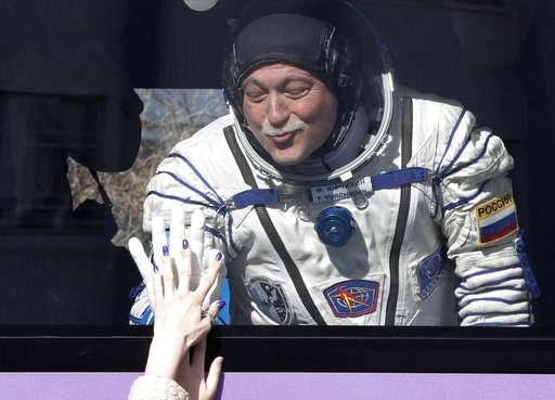 Soyuz space capsule carrying American, Russian blasts off