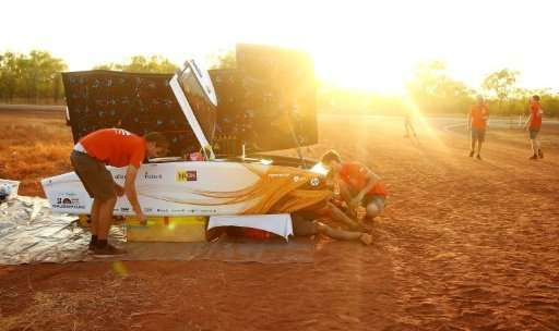 This handout from the World Solar Challenge 2017 shows team members of Nuon Solar Team from the Netherlands preparing their vehi