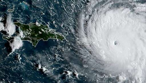 This satellite image obtained from the National Oceanic and Atmospheric Administration (NOAA) shows Hurricane Irma at 1145 UTC o