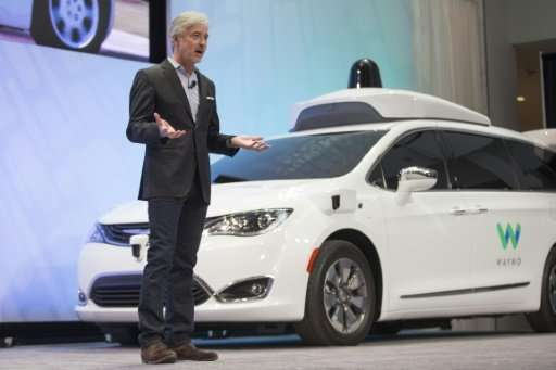 Waymo CEO John Krafcik, seen earlier this year, has announced the former Google car unit is offering autonomous rides for the fi