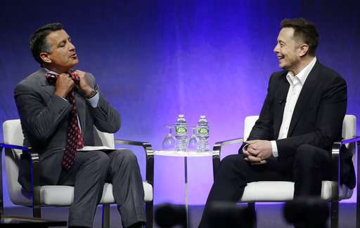 Elon Musk talks cars -- and humanity's fate -- with governors