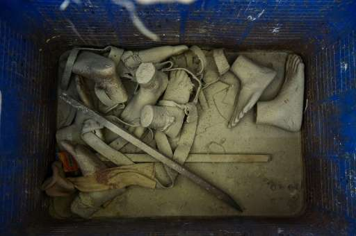 In this photograph taken on June 13, 2017, old prosthetic legs and belts are seen in a dustbin at the Bhagwan Mahaveer Viklang S
