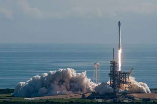 This image obtained from SpaceX shows the company's Falcon 9 rocket carrying the US Air Force's unmanned X-37B drone lifting off