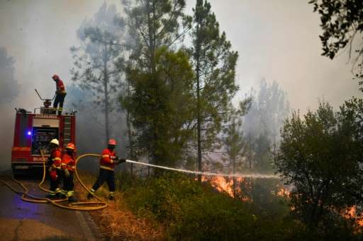 Firefighters battling blazes in central Portugal are worried about the hotter weather forecast, which increases the risk that ol