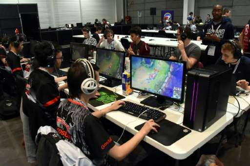Video game players compete against each other, at the Palais des Congres in Bordeaux during the eSports World Convention (ESWC)