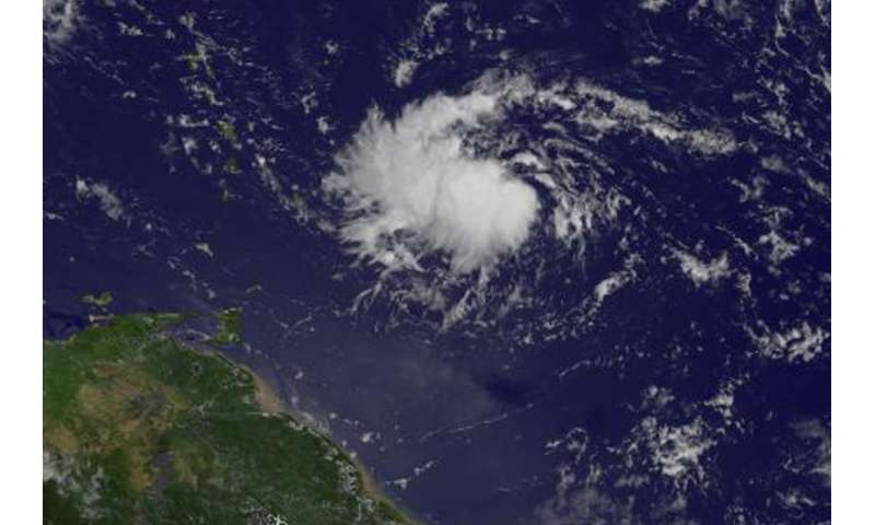 NASA sees Tropical Depression 9 form east of Lesser Antilles