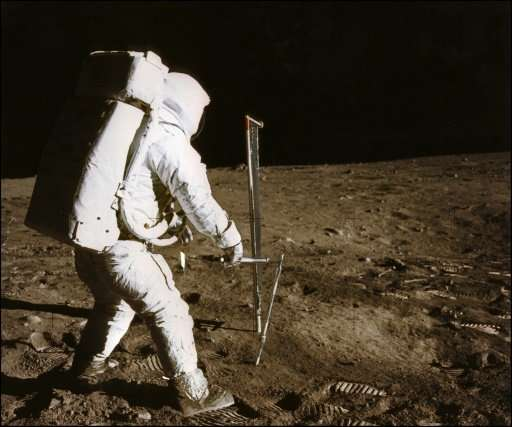 Astronaut Buzz Aldrin conducts an experiment on the moon's surface in this photo taken by his colleague Neil Armstrong, the firs