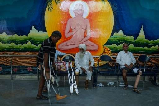 In this photograph taken on June 13, 2017, an Indian man practices walking with a rubber-based prosthetic leg at the Bhagwan Mah
