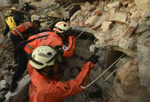 "Members of the ""Topos"" (Moles), a specialized rescue team, search for survivors in Juchitan de Zaragoza following the"