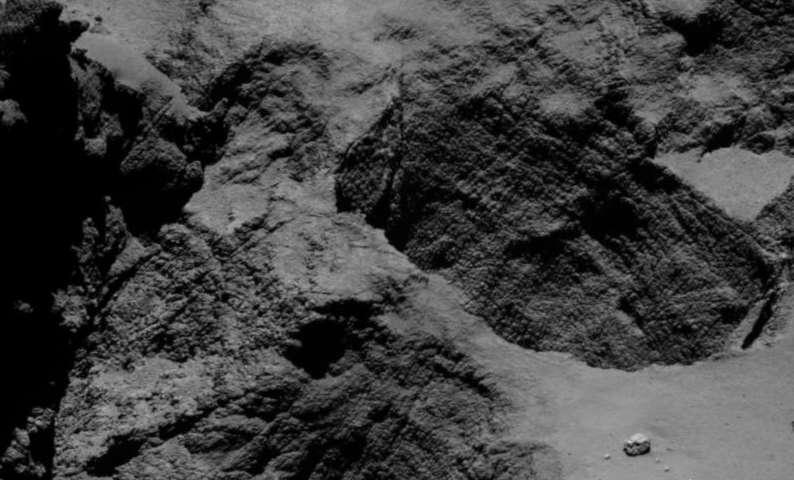 Comet orbiter films deep-space landslide
