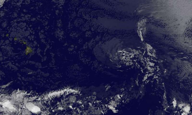 Satellite sees Tropical Depression Greg as a ghostly swirl of clouds