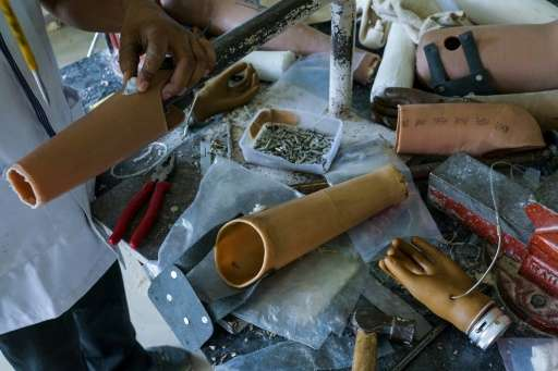 In this photograph taken on June 13, 2017, workers make rubber-based prosthetic legs and hands at the Bhagwan Mahaveer Viklang S