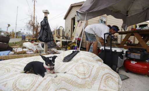 Relief comes slowly for coastal towns recovering from Harvey
