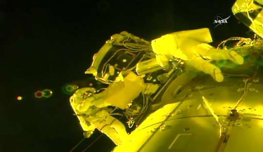 The Latest: Spacewalking astronauts salvage job, back inside