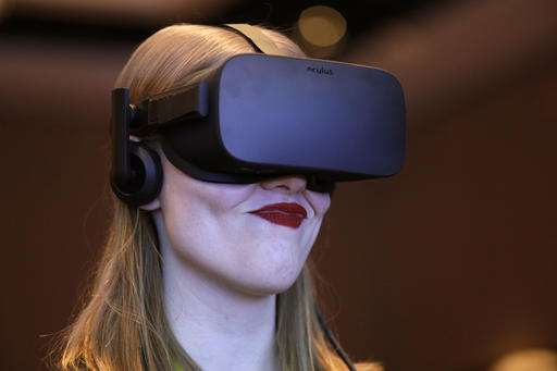 The Latest at CES: Companies up 'wow' factor to stand out