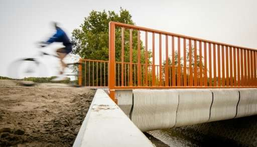 A 3D printer laid some 800 layers of concrete to create the eight-metre bicycle bridge in the Dutch town of Gemert