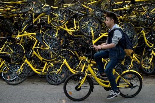 A booming rental bike business has flooded China's streets with packs of cyclists, but their habit of going the wrong way and ab