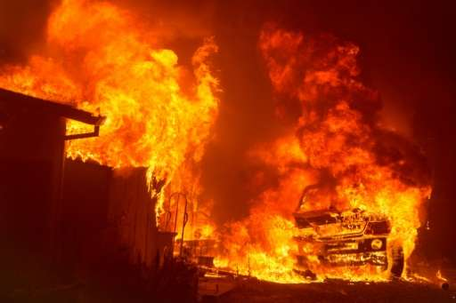 A car and house were engulfed in flames as a wildfire burnt through a residential area in Oroville, California earlier this mont