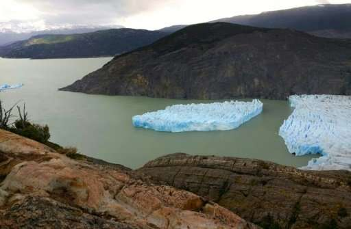 A large piece detaches from the Grey Glacier in Chile's far southern Patagonia region, as seen on Novembeer 28, 2017 in this han