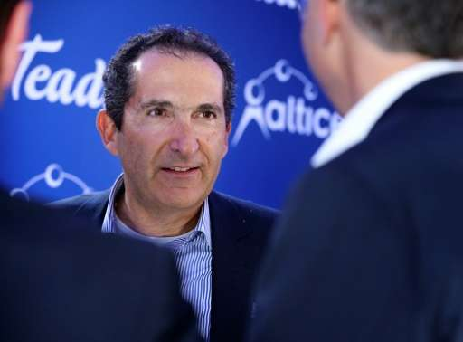 Altice USA, part of the telecom empire of French magnate Patrick Drahi—seen at a March 2017 press conference in Paris—raised som