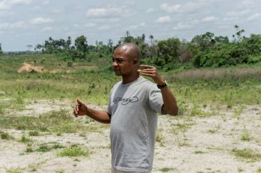 A member of the the Obung community speaks about the Cross River Super Highway, in Calabar, Nigeria