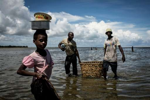 A Mozambican girl arriving to buy fish in Palma, where large deposits of natural gas where found offshore