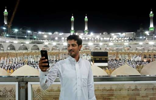 A Muslim pilgrim takes a selfie at the Grand Mosque in the holy Saudi city of Mecca, early on August 30, 2017, on the eve of the