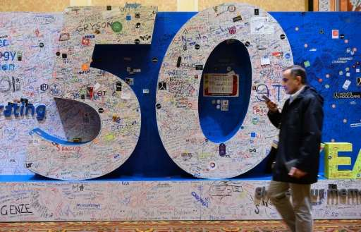 An attendee walks past a message board celebrating 50 years of the Consumer Electronic Show in Las Vegas, Nevada on January 8, 2