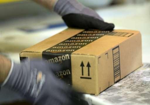 An employee prepares order at Amazon's San Bernardino Fulfillment Center