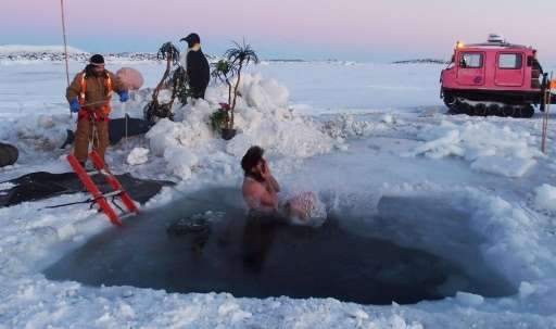 An expeditioner stationed at Australia's Davis Station takes the plunge to celebrate the winter solstice