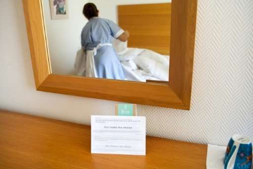 A notice asks guests whether they want linens to be changed, at a five-star hotel in the resort town of Ayia Napa in south-easte