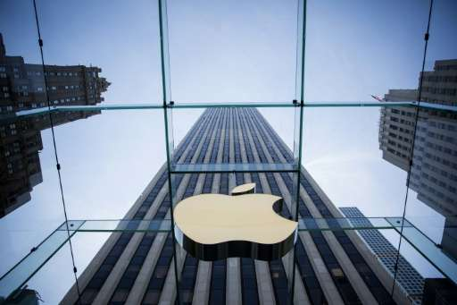 Apple, whose Fifth Avenue in New York is shown here, reported a rise in profit in the past quarter despite a dipin iPhone sales