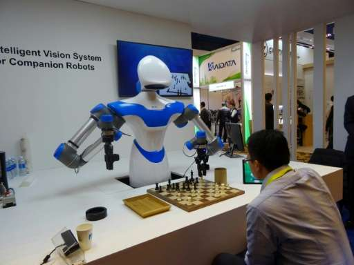 A robot developed by Taiwan's Industrial Technology Research Institute plays chess at the Consumer Electronic Show in Las Vegas,