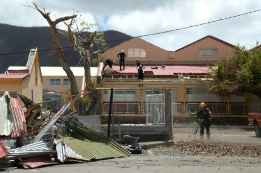 A school is repaired in Marigot on the French Caribbean island of St Martin after Hurricane Irma battered the region earlier thi