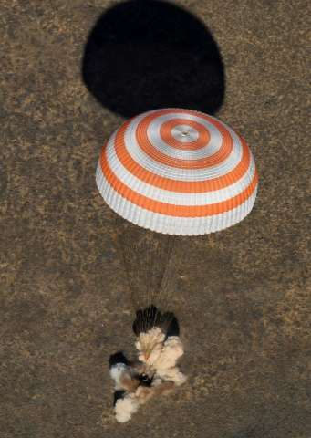 A Soyuz MS-02 capsule brings Russian cosmonauts Sergey Ryzhikov and Andrey Borisenko and US astronaut Shane Kimbrough back home