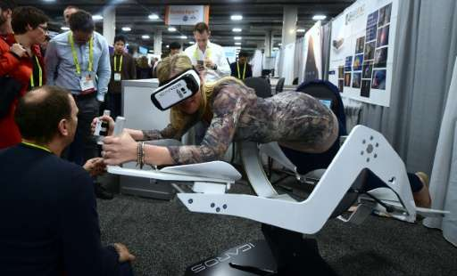 A woman experiences Active VR flying on the Icaros machine during the 2017 Consumer Electronic Show in Las Vegas, Nevada