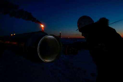 A worker inspects a pipe near the new LNG plant in the port of Sabetta in the Arctic circle