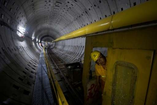 A worker looks out of a train at the construction site of Line 14 of the Shanghai metro system