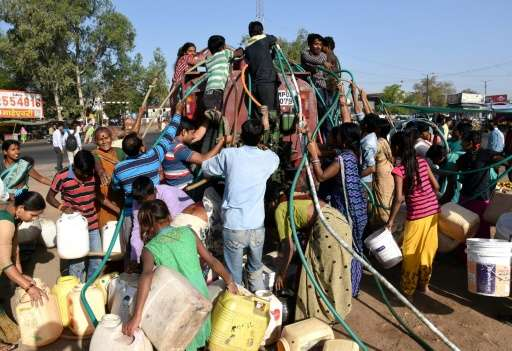 Bhopal residents collect drinking water from a truck, in central India