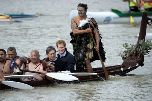 Britain's Prince Harry (2nd R) took a canoe ride along the Whanganui river, the third longest in New Zealand, on a trip to the c
