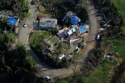 Communities in hurricane-hit Puerto Rico, including this one in Naranjito, have been awaiting billions of dollars worth of aid f