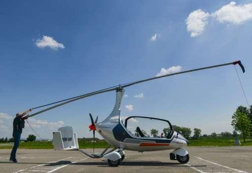 "Czech pilot Pavel Brezina (L), owner of Nirvana Autogyro company, has made a ""GyroDrive""—a mini helicopter you can dri"