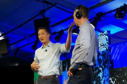 Daniel Chao, co-founder of Halo Neuroscience, displays his company's device to improve brain performance