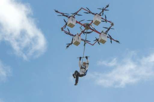 Daredevil Ingus Augstkalns went 'drone-diving' in an isolated area of central Latvia, in what tech company Aerones said was  a w