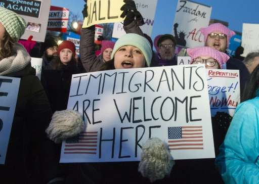 Demonstrators protest against US President Donald Trump and his administration's ban of travelers from seven countries by Execut