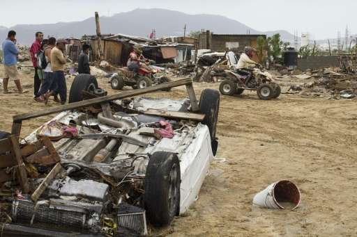 Destroyed cars and debris caused heavy rains following the passage of tropical storm Lidia in Los Cabos, Baja California, Mexico